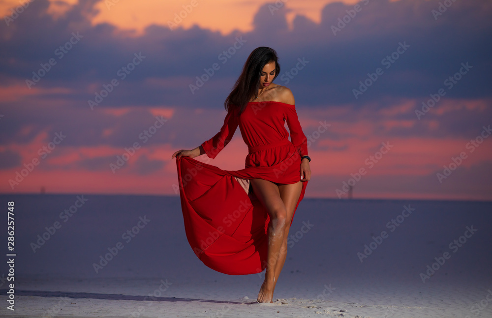 Fototapety, obrazy: Beautiful fashion woman posing in maxi red dress on desert. Summer photo. Cloudy evening sky.