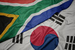 canvas print picture - waving colorful flag of south korea and national flag of south africa.