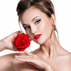 Fototapeta Do Spa Closeup face of beautiful woman with red rose bright makeup