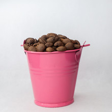 Heap Coffee Beans In Pink Bucket On White Background