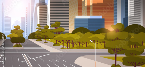 highway asphalt road with marking arrows traffic signs city skyline modern skyscrapers cityscape sunset background flat horizontal