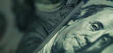 Close Up Franklin's Face  On A One Hundred Dollar. American, US Dollars Cash Money Background.