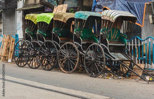 Hand-pulled Rickshaw parked at the Roadside. Billede på lærred