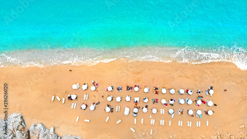 Foto auf AluDibond Turkis Aerial. Top view of people crowd relaxing on a sea beach. Top view from drone.