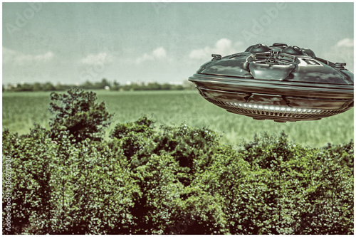 Canvas Print ufo flying over the wood