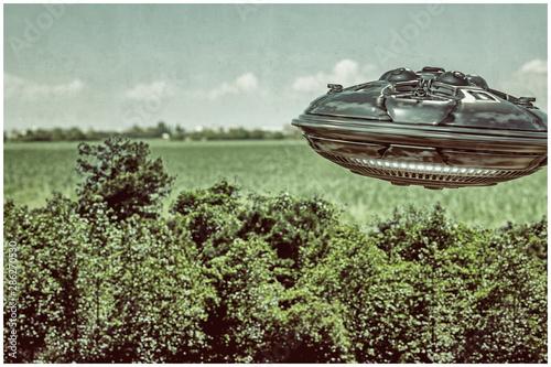 Obraz na plátně ufo flying over the wood