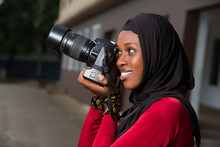 Close-up Of Young Muslim Woman With Camera, Smiling.