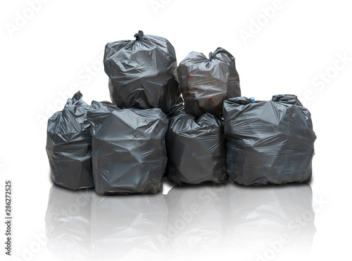 Fototapeta Concept of collecting waste for recycling.Black Plastic Bags for garbage, Bins Big Stack,Trash Pile isolated with clipping path on white background obraz na płótnie
