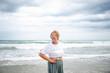 Beautiful mature woman posing on the beach