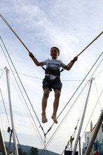 Child Jumping On Bungee Trampoline