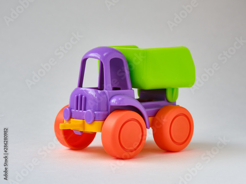 Plastic toy truck on a white background
