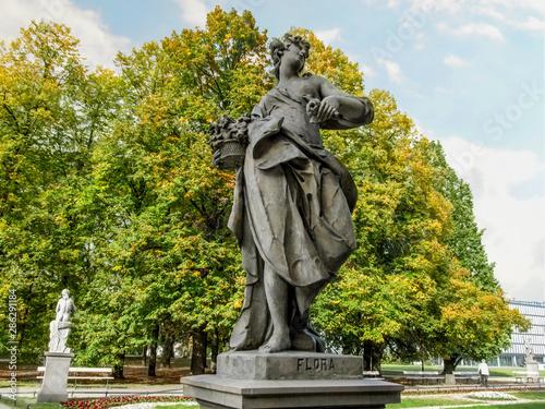 Fényképezés  Sandstone sculpture of the goddess Flora in the Rococo style in Saxon Garden in Warsaw, Poland