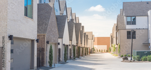 Panoramic large back alley of brand new three story houses community near downto Canvas Print
