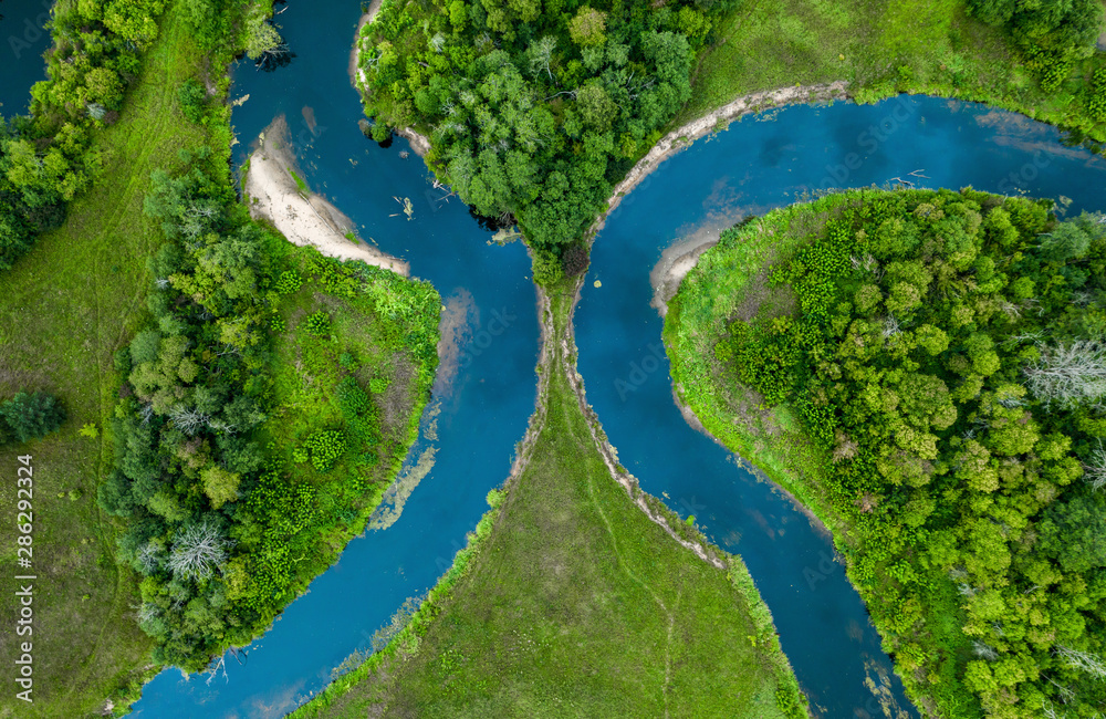 Fototapety, obrazy: Top view drone shot of a green field, forest and river