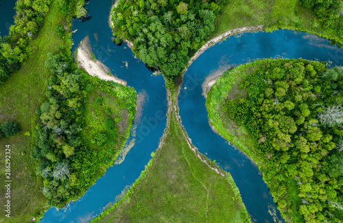 Canvas Prints Forest river Top view drone shot of a green field, forest and river
