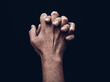 Studio Shot Of Mans Hands Clasped Together