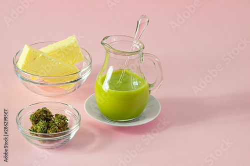 Fototapeta Making Cannabutter for Baking Edibles with Butter and Cannabis or Hemp on Pink Background with Copy Space obraz
