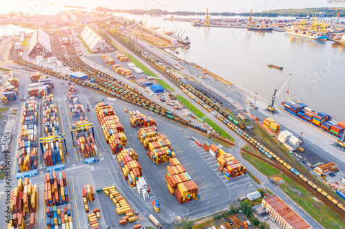 Fotografía Panoramic aerial top view from the heights of the cityscape port harbor and industrial area, container warehouse and railway system network leading to the seaport