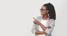 Smiling Black Businesswoman Pointing Finger At Copy Space, White Background