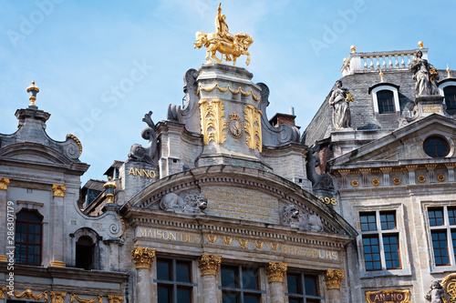 Fotobehang Grand place in Brussels with golden ornaments and blue sky
