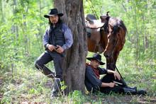Cowboy Riding Horse Against Su...