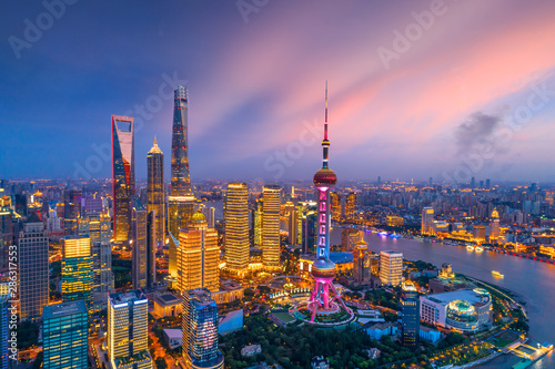 Photo  Aerial view of Shanghai skyline at night,China.
