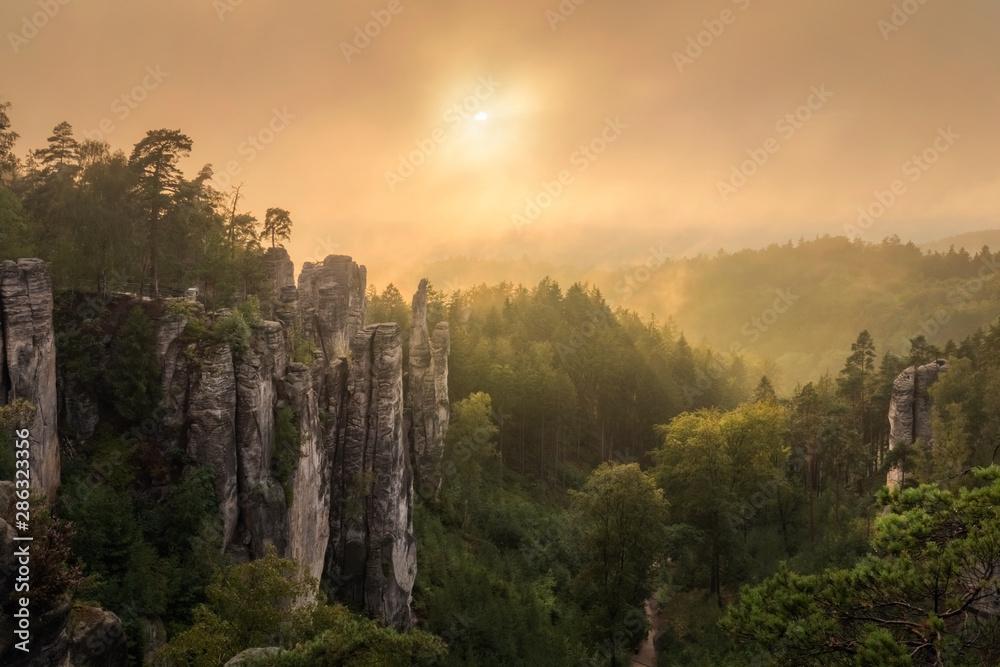 Fototapeta Fairy sunset over Prachovske skaly - Rock towns and formations, Czech Republic