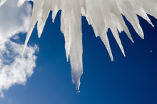 Blue Sky And Icicles In A Cold Winter Day
