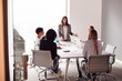 canvas print picture - Female Boss Gives Presentation To Team Of Young Businesswomen Meeting Around Table In Modern Office