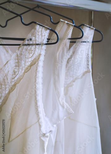 Obraz na plátne Vintage lace bridal wedding white lingerie on hangers, mid century style, select