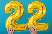 Gold Foil Number 22 Twenty Two Celebration Balloon On Blue Background