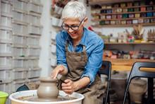 Senior Female Potter Working O...