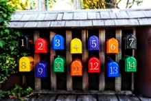 Metallic Mailbox Family In Colorful Rows On The Dock By A Sunny Day In Vancouver