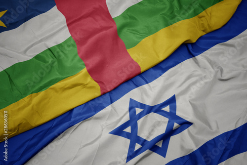 Fototapeta waving colorful flag of israel and national flag of central african republic