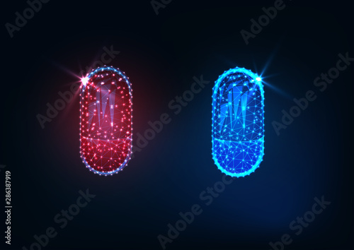 Futuristic glowing low polygonal red and blue medicines capsules isolated on dark blue background Canvas Print
