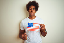 Afro Man Holding United Estates Of America USA Flag Standing Over Isolated White Background With A Confident Expression On Smart Face Thinking Serious