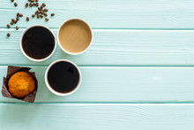 Breakfast With Muffin And Coffee To-go On Mint Green Wooden Background Top View Mockup