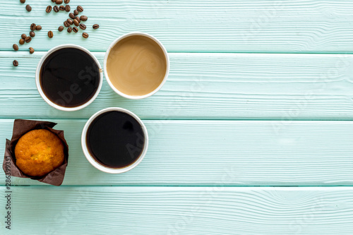 Fototapeta  Breakfast with muffin and coffee to-go on mint green wooden background top view