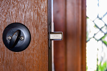 Deadbolt On Wooden Door Engage...