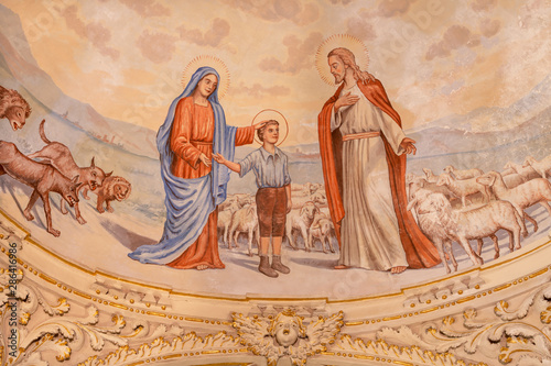 TAORMINA, ITALY - APRIL 9, 2018: The symbolic fresco of boy St. Don Bosco with the Virgin Mary and Jesus from cupola of church Chiesa di San Guseppe from 20. cent.