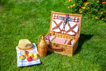 Picnic Basket On Green Sunny Lawn In The Park