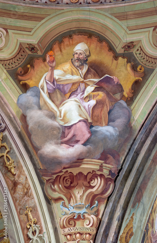 COMO, ITALY - MAY 8, 2015: The fresco of St. Augustine doctor of the west Catholic church in church Santuario del Santissimo Crocifisso by Gersam Turri (1927-1929).