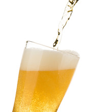 Beer Pouring On Glass Isolated...
