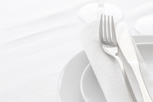 Close Up Of Silverware Fork And Knife With Napkin On The Plate. Copy Space. Restaurant Dinning Concept.