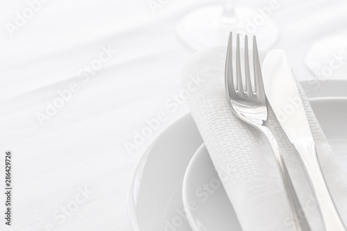 Fototapeta  Close up of silverware fork and knife with napkin on the plate