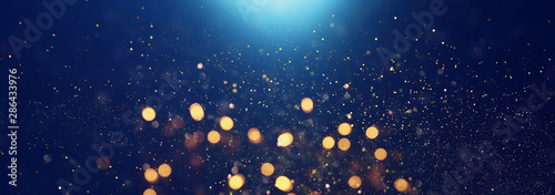 Obraz background of abstract glitter lights. blue, gold and black. de focused. banner - fototapety do salonu