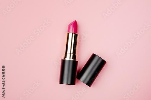 Fotografiet Pink lipstick tube, lip gloss top view