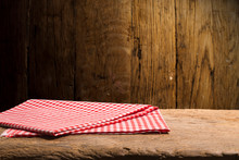 Red Tablecloth On Wooden Backg...