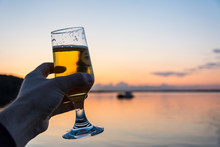 Having A Fresh Cold Beer At The Seashore During A Beautiful Sunset