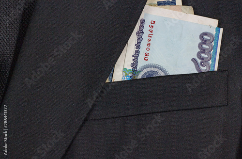 In de dag Kip Business suit pocket with Lao kip, close up